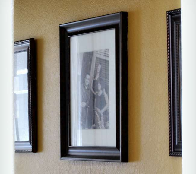 I've found this clever Picture Hanging Tip to be the best, especially for hanging frames with double hooks. Grab your painter's tape and get the tutorial at www.mrshinesclass.com